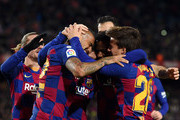 Lionel Messi of FC Barcelona (obscure) celebrates with his team mates after scoring his team's first goal during the La Liga match between FC Barcelona and Granada CF at Camp Nou on January 19, 2020 in Barcelona, Spain.