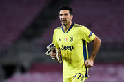 Gianluigi Buffon of Juventus looks on during the UEFA Champions League Group G stage match between FC Barcelona and Juventus at Camp Nou on December 08, 2020 in Barcelona, Spain. Sporting stadiums around Spain remain under strict restrictions due to the Coronavirus Pandemic as Government social distancing laws prohibit fans inside venues resulting in games being played behind closed doors.