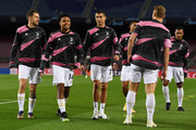 (L-R) Aaron Ramsey, Weston McKennie and Cristiano Ronaldo of Juventus F.C. warm up prior to the UEFA Champions League Group G stage match between FC Barcelona and Juventus at Camp Nou on December 08, 2020 in Barcelona, Spain. Sporting stadiums around Spain remain under strict restrictions due to the Coronavirus Pandemic as Government social distancing laws prohibit fans inside venues resulting in games being played behind closed doors.
