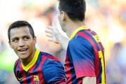 Alexis Sanchez of FC Barcelona (L) celebrates with his team-mate Lionel Messi after scoring the opening goal during the La Liga match between FC Barcelona and Levante UD at Camp Nou on August 18, 2013 in Barcelona, Spain.
