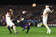 Lionel Messi of Barcelona attempts a over head kick as Phil Jones of Manchester United attempts to block during the UEFA Champions League Quarter Final second leg match between FC Barcelona and Manchester United at Camp Nou on April 16, 2019 in Barcelona, Spain.