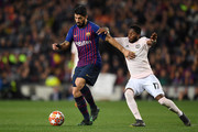 Luis Suarez of Barcelona is challenged by Fred of Manchester United during the UEFA Champions League Quarter Final second leg match between FC Barcelona and Manchester United at Camp Nou on April 16, 2019 in Barcelona, Spain.
