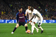 Lionel Messi and Ashley Young Photos - 1 of 2 Photo