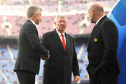Sir Alex Ferguson speaks to Ole Gunnar Solskjaer, Manager of Manchester United and Mike Phelan on the pitch prior to the UEFA Champions League Quarter Final second leg match between FC Barcelona and Manchester United at Camp Nou on April 16, 2019 in Barcelona, Spain.