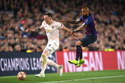 Phil Jones of Manchester United is challenged by Arturo Vidal of Barcelona during the UEFA Champions League Quarter Final second leg match between FC Barcelona and Manchester United at Camp Nou on April 16, 2019 in Barcelona, Spain.
