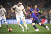 Lionel Messi of Barcelona in action with Phil Jones of Manchester United during the UEFA Champions League Quarter Final second leg match between FC Barcelona and Manchester United at Camp Nou on April 16, 2019 in Barcelona, Spain.