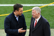 Gary Neville speaks to Sir Alex Ferguson prior to the UEFA Champions League Quarter Final second leg match between FC Barcelona and Manchester United at Camp Nou on April 16, 2019 in Barcelona, Spain.