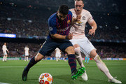 Luis Suarez of Barcelona is challenged by Phil Jones of Manchester United during the UEFA Champions League Quarter Final second leg match between FC Barcelona and Manchester United at Camp Nou on April 16, 2019 in Barcelona, Spain.