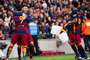 Lionel Messi of FC Barcelona celebrates with his teammates Luis Suarez (L), Dani Alves (2nd R) and Sergio Busquets (R) after scoring the opening goal during the La Liga match between FC Barcelona and RC Deportivo La Coruna at Camp Nou on December 12, 2015 in Barcelona, Spain.