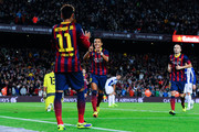 Alexis Sanchez (C) of FC Barcelona celebrates with his team-mate Neymar of FC Barcelona after scoring the opening goal during the La Liga match between FC Barcelona and RCD Espanyol at Camp Nou on November 1, 2013 in Barcelona, Spain.