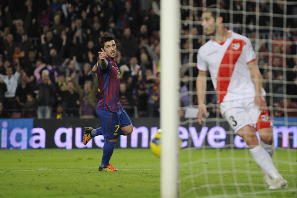 David Villa of FC Barcelona (L) celebrates after scoring his team's third goal during the La Liga match between FC Barcelona and Rayo Vallecano at Camp Nou on November 29, 2011 in Barcelona, Spain.