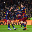 Arda Turan and Lionel Messi