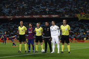 Lionel Messi of Barcelona and Sergio Ramos of Real Madrid line up with the match officials during the Liga match between FC Barcelona and Real Madrid CF at Camp Nou on December 18, 2019 in Barcelona, Spain.