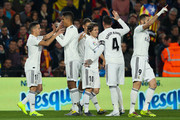 Lucas Vazquez of Real Madrid CF celebrates with his team mates after scoring his team's first goal during the Copa del Semi Final first leg match between Barcelona and Real Madrid at Nou Camp on February 06, 2019 in Barcelona, Spain.