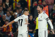 Lucas Vazquez of Real Madrid CF celebrates with his team mate Sergio Ramos after scoring his team's first goal during the Copa del Semi Final first leg match between Barcelona and Real Madrid at Nou Camp on February 06, 2019 in Barcelona, Spain.