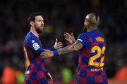 Lionel Messi of FC Barcelona celebrates with Arturo Vidal of FC Barcelona after scoring his sides first goal  during the La Liga match between FC Barcelona and Real Sociedad at Camp Nou on March 07, 2020 in Barcelona, Spain.
