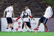 Jerome Boateng (R) is challenged by Thomas Mueller during a training session on day 2 of the FC Bayern Muenchen training camp at ASPIRE Academy for Sports Excellence on January 3, 2018 in Doha, Qatar.