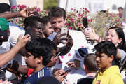 Thomas Mueller poses for a selfie with fans after a training session on day 3 of the FC Bayern Muenchen training camp at ASPIRE Academy for Sports Excellence on January 4, 2018 in Doha, Qatar.