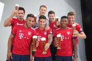 (L-R) Mats Hummels, Corentin Tolisso, Manuel Neuer, James Rodriguez, Robert Lewandowski, David Alaba dn Thomas Mueller of FC Bayern Muenchen during the FC Bayern Muenchen and Paulaner Photo Session at FGV Schmidtle Studios on September 2, 2018 in Munich, Germany. .The traditional photo shoot featuring FC Bayern Muenchen for the Paulaner brewery who have been a platinum partner with Bayern Muenchen since 2003. Giving some of the stars from Germany?s record-breaking football team and their trainer Niko Kovac the opportunity to get in touch with some Bavarian culture by dressing for the shoot in Lederhosen the traditional attire of Bavaria.