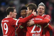 (LtoR) Bayern Munich's  Austrian defender David Alaba, striker Thomas Mueller and Polish striker Robert Lewandowski celebrate after the first goal during the German first division Bundesliga football match between FC Bayern Munich and FC Cologne on December 13, 2017 in Munich. / AFP PHOTO / Christof STACHE / RESTRICTIONS: DURING MATCH TIME: DFL RULES TO LIMIT THE ONLINE USAGE TO 15 PICTURES PER MATCH AND FORBID IMAGE SEQUENCES TO SIMULATE VIDEO. == RESTRICTED TO EDITORIAL USE == FOR FURTHER QUERIES PLEASE CONTACT DFL DIRECTLY AT + 49 69 650050.