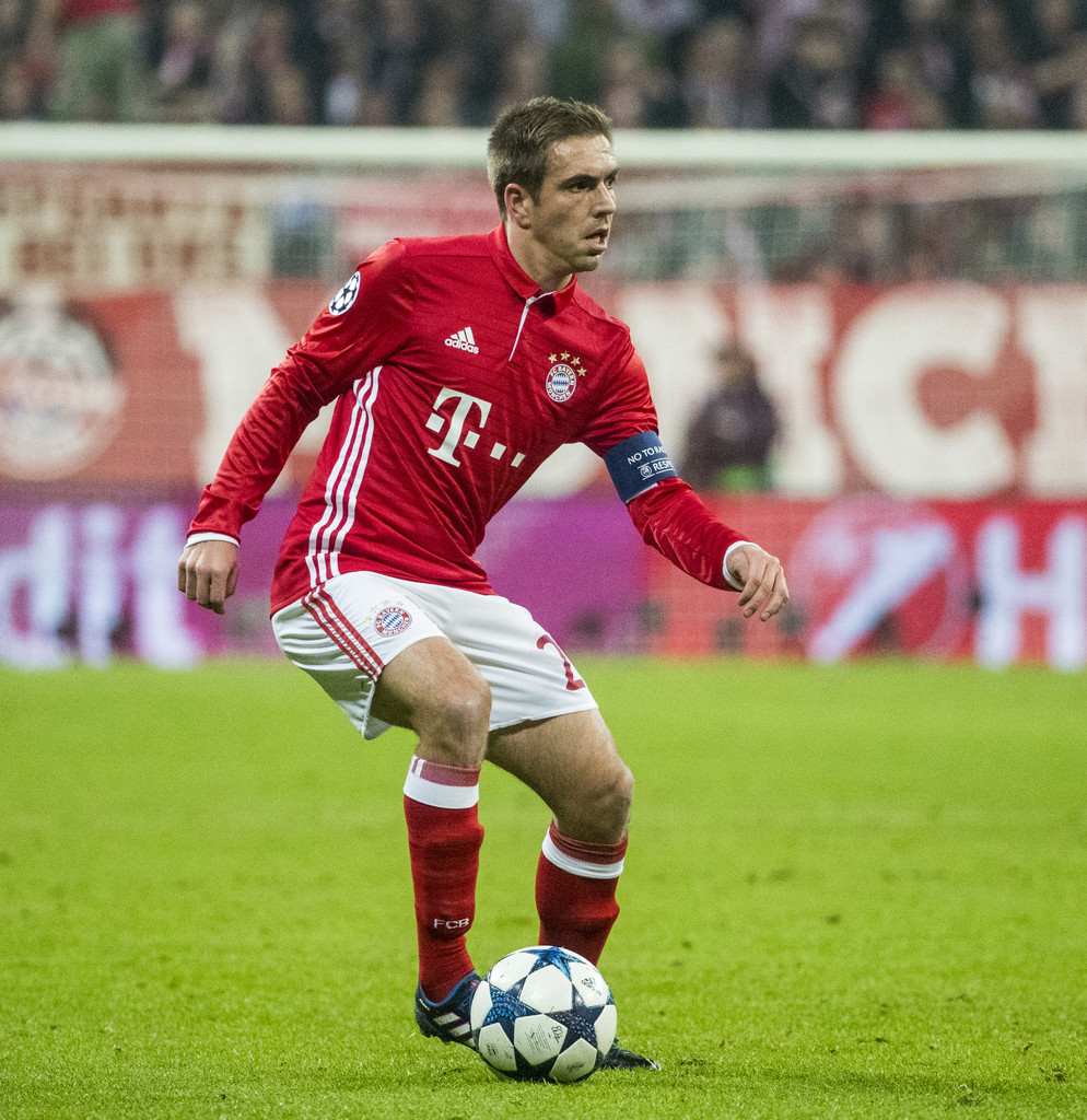 philipp lahm photos photos fc bayern muenchen v arsenal fc uefa champions league round of 16. Black Bedroom Furniture Sets. Home Design Ideas