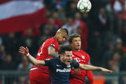 Thomas Mueller and Arturo Vidal Photos Photo