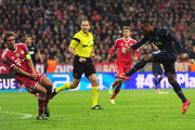 Patrice Evra of Manchester United scores his goal during the UEFA Champions League Quarter Final second leg match between FC Bayern Muenchen and Manchester United at Allianz Arena on April 9, 2014 in Munich, Germany.