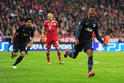 Patrice Evra (R) of Manchester United celebrates his goal during the UEFA Champions League Quarter Final second leg match between FC Bayern Muenchen and Manchester United at Allianz Arena on April 9, 2014 in Munich, Germany.