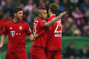 Thomas Mueller (R) of Muenchen celebrates scoring the 2nd team goal with his team mate Arturo Vidal during the DFB Cup semi finale match between FC Bayern Muenchen and Werder Bremen at Allianz Arena on April 19, 2016 in Munich, Germany.