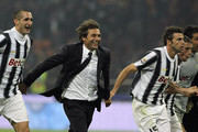 Antonio Conte (C) manager of Juventus FC celebrates a victory with Giorgio Chiellini (L), Andrea Barzagli, Claudio Marchisio and Gianluigi Buffon at the end of the Serie A match between FC Internazionale Milano and Juventus FC at Stadio Giuseppe Meazza on October 29, 2011 in Milan, Italy.
