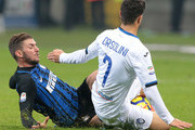 Davide Santon of FC Internazionale Milano (L) competes for the ball with Riccardo Orsolini of Atalanta BC during the Serie A match between FC Internazionale and Atalanta BC at Stadio Giuseppe Meazza on November 19, 2017 in Milan, Italy.