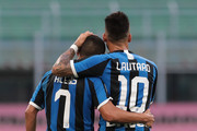 Alexis Sanchez of FC Internazionale celebrates after scoring the second goal of his team via penalty with his team-mate Lautaro Martinez during the Serie A match between FC Internazionale and Brescia Calcio at Stadio Giuseppe Meazza on July 1, 2020 in Milan, Italy.