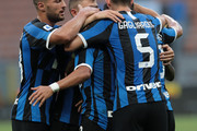 Alexis Sanchez of FC Internazionale celebrates his goal with his team-mate during the Serie A match between FC Internazionale and Brescia Calcio at Stadio Giuseppe Meazza on July 1, 2020 in Milan, Italy.