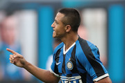 Alexis Sanchez of FC Internazionale celebrates after scoring the second goal of his team via penalty during the Serie A match between FC Internazionale and Brescia Calcio at Stadio Giuseppe Meazza on July 1, 2020 in Milan, Italy.