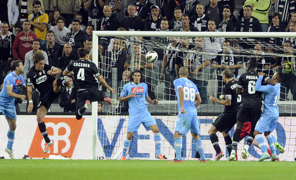 Martin Caceres of FC Juventus #4 scores the first goal during the Serie A match between FC Juventus and SSC Napoli at Juventus Arena on October 20, 2012 in Turin, Italy.