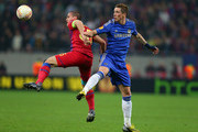 Fernando Torres of Chelsea battles with Alexandru Bourceanu of FC Steaua during the UEFA Europa League Round of 16 match between FC Steaua Bucuresti and Chelsea at the National Arena on March 7, 2013 in Bucharest, Romania.