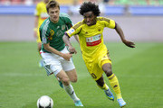 Oleg Ivanov (L) of FC Terek Grozny is challenged by Willian of FC Anzhi Makhachkala during the Russian Premier League match between FC Terek Grozny and FC Anzhi Makhachkala at the Akhmad-Arena Stadium on May 12, 2013 in Grozny, Russia.
