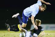Jack PETRIE of Heidelberg tackles Scott SMITH of Charlestown during the FFA Cup round of 32 match between Heidelberg United and Charlestown City Blues at Olympic Village on August 1, 2018 in Melbourne, Australia.