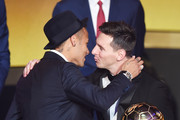 Lionel Messi of Argentina and FC Barcelona the winner of the Ballon d'or is congratulated by Neymar Jr of Brazil and FC Barcelona during the FIFA Ballon d'Or Gala 2015 at the Kongresshaus on January 11, 2016 in Zurich, Switzerland.