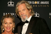 Jeff Bridges (R) and Susan Geston attend FIJI Water at the 76th Annual Golden Globe Awards Celebration on January 6, 2019 in Los Angeles, California.