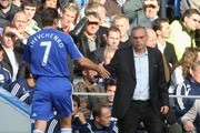Andriy Shevchenko of Chelsea shakes the hand of Avram Grant, Chelsea manager as he is substituted during the Barclays Premier League match between Chelsea and Fulham at Stamford Bridge on September 29, 2007 in London.