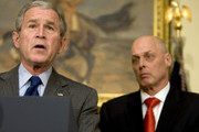 (AFP OUT) US President George W. Bush (L) makes a statement on the economy as Treasury Secretary Henry Paulson looks on in the Roosevelt Room of the White House January 18, 2008 in Washington, DC. Bush spoke of a stimulus package worth approximately $150 billion.