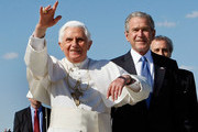 (AFP OUT)  Pope Benedict XVI reacts to the cheering crowd as he stands with  U.S. President George W. Bush upon his arrival at Andrews Air Force Base, April 15, 2008 in Camp Springs, Maryland. On Wednesday Pope Benedict XVI will visit the White House and on Thursday he will he will say Mass at the Nationals Baseball stadium.