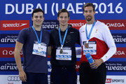 (L-R) Silver medal winner James Guy of Great Britain, Gold medal winner Myles Brown of South Africa and Bronze medal winner Pieter Timmers of Belgium celebrate on the podium after the Men's 200m Freestyle finals during day two of the FINA Swimming World Cup Dubai 2016 at Hamdan Sports Complex  on October 5, 2016 in Dubai, United Arab Emirates.