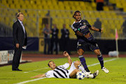 Kanu of RSC Anderlecht and Ivan Stevanovic of FK Partizan during the Champions League Play-off match between Partizan and Anderlecht at Partizan Stadium on August 18, 2010 in Belgrade, Serbia.