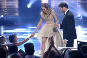 "Actress/singer Jennifer Lopez (L) and singer Harry Connick, Jr. onstage during FOX's ""American Idol"" Finale For The Farewell Season at Dolby Theatre on April 7, 2016 in Hollywood, California. at Dolby Theatre on April 7, 2016 in Hollywood, California."