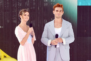 Maia Mitchell (L) and KJ Apa speak onstage during FOX's Teen Choice Awards 2019 on August 11, 2019 in Hermosa Beach, California.