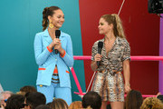 Maddie Ziegler (L) and Candace Cameron Bure speak onstage during FOX's Teen Choice Awards 2019 on August 11, 2019 in Hermosa Beach, California.