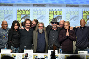 (L-R) Executive producer/director Paris Barclay, actors Katey Sagal, Kim Coates, creator/executive producer Kurt Sutter, actors Mark Boone Junior, Tommy Flanagan, Dayton Callie, Theo Rossi and David Labrava attend FX's 'Sons of Anarchy' panel during Comic-Con International 2014 at San Diego Convention Center on July 27, 2014 in San Diego, California.