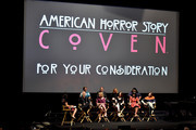 """(L-R, front) VULTURE Senior Editor Denise Martin, co-creator/executive producer/writer Ryan Murphy, actors Jessica Lange, Sarah Paulson, Angela Bassett, co-creator/executive producer Brad Falchuk, (L-R, rear) actor Denis O'Hare, executive producer Tim Minear, actors Frances Conroy and Gabourey Sidibe appear onstage at a screening and conversation with Fox's """"American Horror Story: Coven"""" at Twientieth Century Fox Studios on June 6, 2014 in Los Angeles, California."""